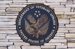Featured is the Department of Veterans Affairs seal. (Photo credit: Robert Alexander/Getty Images)
