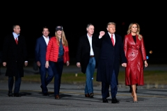 US president Donald Trump (2nd R) holds up his fist as he arrives with First Lady Melania Trump (R) and Georgia Republican Senators David Perdue (C) and Kelly Loeffler for a rally to support Republican Senate candidates at Valdosta Regional Airport in Valdosta, Georgia on December 5, 2020. (Photo by ANDREW CABALLERO-REYNOLDS/AFP via Getty Images)