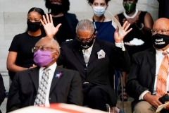 Rep. Gregory Meeks, D-N.Y., with hands raised, at a memorial service last July for the late Rep. John Lewis.  (Photo by J. Scott Applewhite/Pool/AFP via Getty Images)