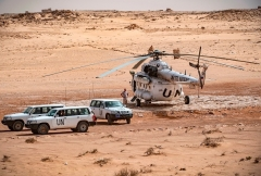 A U.N. mission helicopter and vehicles in Western Sahara last month (Photo by Fadel Senna/AFP via Getty Images)