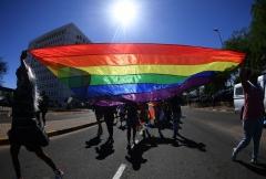 Activists carry an LGBT flag. (Photo credit: MONIRUL BHUIYAN/AFP via Getty Images)