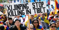 Tibetans protest against Chinese policies outside the U.N. Human Rights Council in Geneva. (Photo by Fabrice Coffrini/AFP via Getty Images)