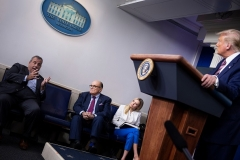 Former New York City Mayor Rudy Giuliani, White House Press Secretary Kayleigh McEnany, and President Donald Trump listen while former New Jersey Governor Chris Christie speaks during a briefing at the White House September 27, 2020. (Photo by BRENDAN SMIALOWSKI/AFP via Getty Images)