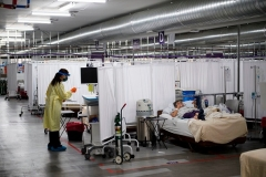 With hospitals overflowing, a patient recovers in the Covid-19 alternative care site, built into a parking garage, at Renown Regional Medical Center in Reno, Nevada on December 16, 2020. (Photo by PATRICK T. FALLON/AFP via Getty Images)