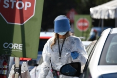 A healthcare worker wears protective gear at a coronavirus testing site in Los Angeles, California on November 30, 2020 following the Thanksgiving holiday. (Photo by ROBYN BECK/AFP via Getty Images)