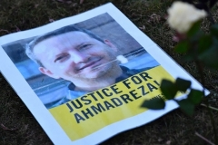 A flyer at a protest outside the Iranian Embassy in Brussels calls for justice for Ahmadreza Djalali, the physician on death row in an Iranian prison. (Photo by Dirk Waem/AFP via Getty Images)