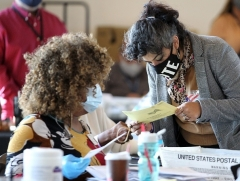Fulton County election workers examine ballots on November 5, 2020, in Atlanta. (Photo by TAMI CHAPPELL/AFP via Getty Images)