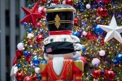 A nutcracker, part of a Christmas display, wears a mask on November 28, 2020 in New York City. (Photo by Alexi Rosenfeld/Getty Images)