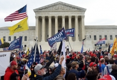 Trump supporters protest problems with the 2020 presidential election in front of the US Supreme Court on December 12, 2020.  (Photo by OLIVIER DOULIERY/AFP via Getty Images)