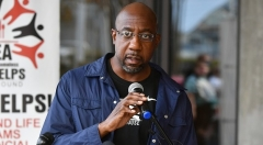 Raphael Warnock, the pastor of Atlanta's Ebenezer Baptist Church, faces Republican Sen. Kelly Loeffler in January's crucial runoff. (Photo by Paras Griffin/Getty Images)
