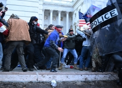 Trump supporters clash with police and security forces, as they storm the U.S. Capitol in Washington, D.C., on Jan. 6, 2021. (Photo credit: BRENDAN SMIALOWSKI/AFP via Getty Images)