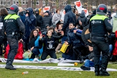 Protesters clash with riot police in Amsterdam early this week. (Photo by Niels Wenstedt/BSR Agency/Getty Images)