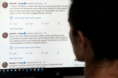 """This illustration photo shows an editor in Los Angeles looking at the official Twitter account of US President Donald Trump on May 26, 2020, with two tweets by the president under which Twitter posted a link reading """"Get the facts about mail-in ballots"""". (Photo by AFP via Getty Images)"""