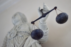 Lady Justice holds her scales. (Photo credit: LOIC VENANCE/AFP via Getty Images)