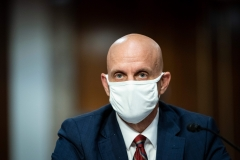Stephen Hahn, commissioner of food and drugs at the U.S. Food and Drug Administration (FDA), wears a protective covering during a Senate Health, Education, Labor and Pensions Committee hearing. (Photo credit: AL DRAGO/AFP via Getty Images)