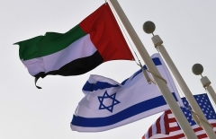 The Israeli, UAE and United States national flags fly at Abu Dhabi airport.  (Photo by Karim Sahib/AFP via Getty Images)