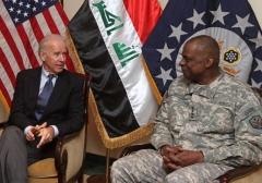 Then-Vice President Joe Biden meets with Gen. Lloyd Austin at the U.S. Embassy in Iraq, Nov. 29, 2011. (Ahmad Al-Rubaye/AFP via Getty Images)