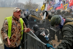 A Trump supporter screams at police and security forces as demonstrators storm the US Capitol on January 6, 2021. (Photo by JOSEPH PREZIOSO/AFP via Getty Images)