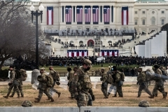 National Guard troops carry riot shields near the US Capitol at the inauguration of Joe Biden on January 20, 2021. (Photo by ROBERTO SCHMIDT/AFP via Getty Images)