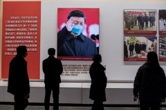 An image of Chinese President Xi Jinping features in an exhibition in Wuhan about China's response to the coronavirus outbreak.  (Photo by Nicolas Asfouri/AFP via Getty Images)