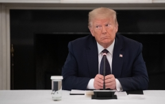 Former President Donald Trump participates in a meeting. (Photo credit: SAUL LOEB/AFP via Getty Images)