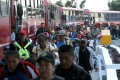 Central American migrants -mostly Hondurans- moving in a caravan towards the United States, board buses to head to a shelter in the outskirts of Zapotlanejo, Jalisco state, Mexico, on November 11, 2018. - The United States embarked Friday on a policy of automatically rejecting asylum claims of people who cross the Mexican border illegally in a bid to deter Central American migrants and force Mexico to handle them. (Photo by ULISES RUIZ/AFP via Getty Images)