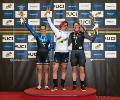 Canadian cyclist Rachel McKinnon (C) celebrates her gold medal on the podium with bronze medalist Kirsten Herup Sovang (R) of Denmark and silver medalist Dawn Orwick (L) of the USA, for the F35-39 Sprint discipline of the UCI Masters Track Cycling World Championships, in Manchester on October 19, 2019. - Transgender cyclist Rachel McKinnon has defended her right to compete in women's sport despite accepting trans athletes may retain a physical advantage over their rivals. (Photo by OLI SCARFF / AFP)