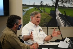 Texas Governor Greg Abbott (R), with US Senator Ted Cruz (L), attends a briefing for US President Donald Trump (off camera) in Orange, Texas, on August 29, 2020. Trump surveyed damage in the area caused by Hurricane Laura. - At least 15 people were killed after Laura slammed into the southern US states of Louisiana and Texas, authorities and local media said on August 28. (Photo by ROBERTO SCHMIDT/AFP via Getty Images)