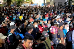 Thousands of Honduran migrants push through the police fence as they attempt to cross the border at El Florido in Guatemala forming the first migrant caravan of the year on it's way to the United States on January 15, 2021. (Photo by JOHAN ORDONEZ/AFP via Getty Images)