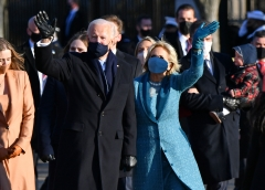 President Joe Biden, First Lady Jill Biden, and their family walk up Pennsylvania Avenue towards the White House. (Photo credit: MANDEL NGAN/AFP via Getty Images)