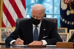 President Joe Biden signs an executive order reversing Trump era ban on transgenders serving in the military. (Photo credit: JIM WATSON/AFP via Getty Images)