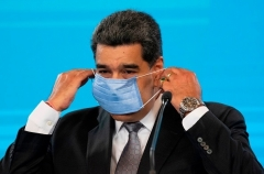 Venezuela's Nicolas Maduro dons a mask after a press conference in Caracas last week. (Photo by Yuri Cortez/AFP via Getty Images)