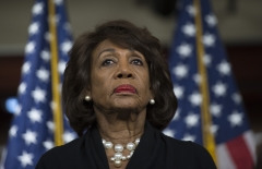 Rep. Maxine Waters (D-CA) looks on before speaking to reporters regarding the Russia investigation. (Photo credit: ANDREW CABALLERO-REYNOLDS/AFP via Getty Images)