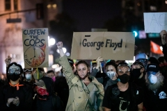 "Demonstrators attend a ""Sit Out the Curfew"" protest against the death of George Floyd who died on May 25 in Minneapolis whilst in police custody, along a street in Oakland, Calif. on June 3, 2020. (Photo credit: PHILIP PACHECO/AFP via Getty Images)"