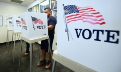 Voters cast their ballots for early voting at the Los Angeles County Registrar's Office in Norwalk, Calif. (Photo credit: FREDERIC J. BROWN/AFP via Getty Images)