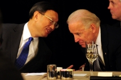Yang Jiechi (then Chinese foreign minister) speaks with then-Vice President Joe Biden at a luncheon in Los Angeles in 2012. (Photo by Frederic J. Brown/AFP via Getty Images)