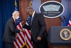 President Joe Biden elbow bumps Secretary of Defense Lloyd Austin during a visit to the Pentagon on February 10, 2021. (Photo by SAUL LOEB/AFP via Getty Images)