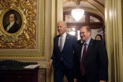 Then-Vice President Joe Biden joins Sen. Chris Coons (D-Del.) at a tribute to Biden in the Capitol in December 2016. (Photo by NICHOLAS KAMM/AFP via Getty Images)