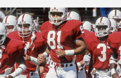 Cory Booker, 81, jogs onto the field at Stanford for a game in the 1989 season. (Photo by David Madison/Getty Images)
