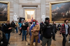 Supporters of US President Donald Trump walk around in the Rotunda after breaching the US Capitol on January 6, 2021. (Photo by SAUL LOEB/AFP via Getty Images)