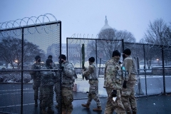 Members of the National Guard are seen at a Capitol security checkpoint on February 1, 2021. (Photo by BRENDAN SMIALOWSKI/AFP via Getty Images)