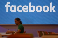 An employee in the canteen at Facebook's London headquarters. (Photo by Daniel Leal-Olivas/AFP via Getty Images)