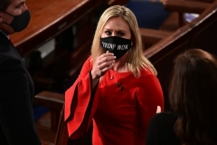 "Rep. Marjorie Taylor Greene (R-Ga.) wears a ""Trump Won"" face mask as she arrives on the floor of the House to take her oath of office on January 3, 2021.(Photo by ERIN SCOTT/POOL/AFP via Getty Images)"