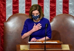 A shaken Speaker of the House Nancy Pelosi (D-Calif.) speaks as the House chamber reconvened after the storming of the Capitol on Jan. 6, 2021. (Photo by JIM LO SCALZO/POOL/AFP via Getty Images)