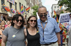 Sen. Chuck Schumer (D.-N.Y.), right, his daughter Alison, left, and her wife Elizabeth Weiland, center, take part in the NYC Pride March, commemorating the 50th Anniversary of the Stonewall Uprising, June 30, 2019. (Photo by ANGELA WEISS/AFP via Getty Images)