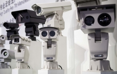 AI security cameras using facial recognition technology are displayed at an exhibition in Beijing in 2018. (Photo by Nicolas Asfouri/AFP via Getty Images)