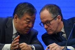 Leader of the international coronavirus origin study team, Peter Ben Embarek, right, confers with the head of the Chinese team, Liang Wannian, during an end-of-mission press conference in Wuhan in February. (Photo by Hector Retamal/AFP via Getty Images)