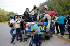 Guatemalan police officers return illegal Honduran immigrants to their country, in El Florido, in the Honduran department of Copan across their border, as migrants wanting to reach the United States start gathering with the hope of crossing the border into Guatemala to begin the first US-bound caravan of the year, on January 15, 2021. (Photo by JOHAN ORDONEZ/AFP via Getty Images)