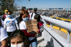 Migrants hold a demonstration demanding clearer United States migration policies, at San Ysidro crossing port in Tijuana, Baja California state, Mexico on March 2, 2021. (Photo by GUILLERMO ARIAS/AFP via Getty Images)