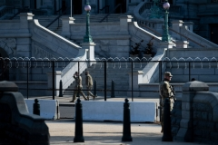 Members of the National Guard patrol the grounds of the US Capitol on March 4, 2021, in Washington, DC. (Photo by BRENDAN SMIALOWSKI/AFP via Getty Images)